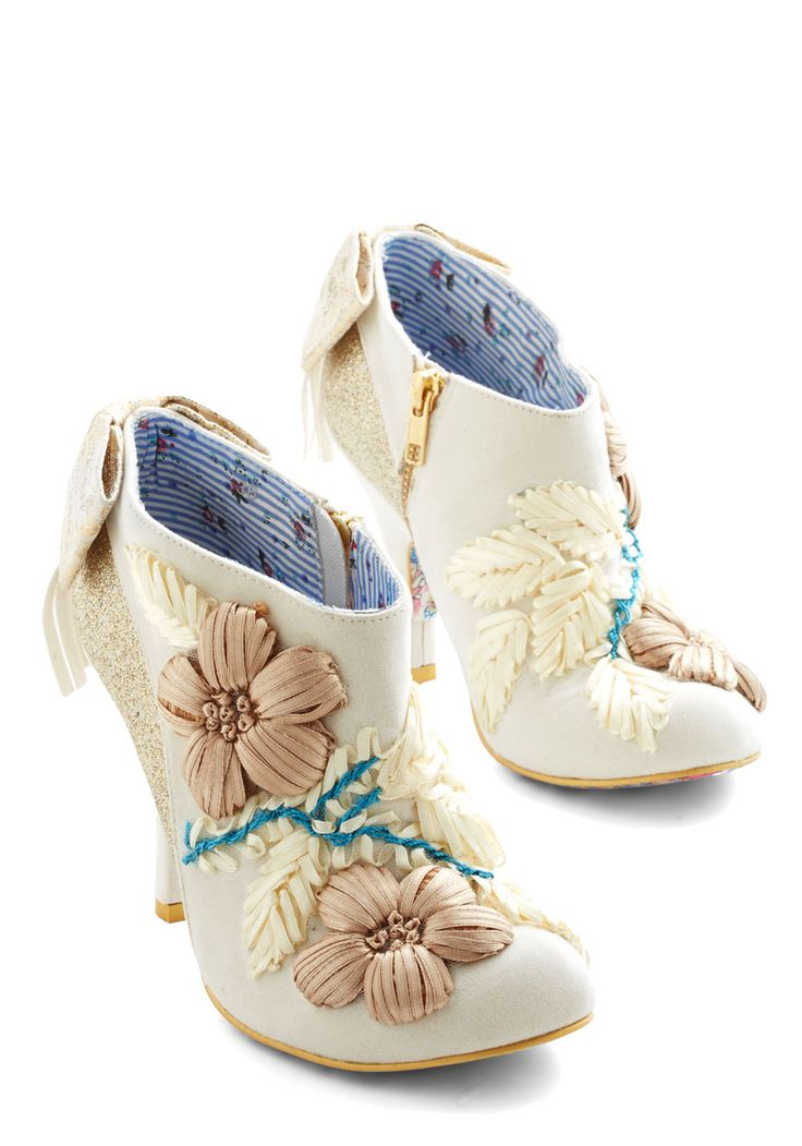 Enamor, More, More Heel. Its the glamour the merrier when it comes to these ivory booties from Irregular Choice!