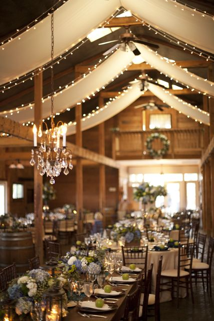 This event featured over 250 yards of poplin fabric, the installation of chandeliers and white twinkle lights. Gorgeous for a fairytale-style wedding.