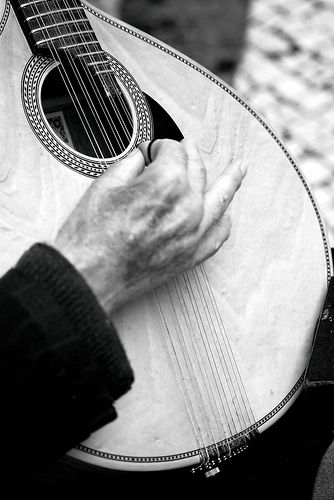 """Playing in the street to survive!  My reverence to the aged! but not dead!  This man, playing in the street, would have near 80 years old!  I ask for him if I can do a shot and he, blind, with a great smile said: YES!  He played for me one old ""fado""!  With difficulty I didn't cry!"" photo and caption by Carlos de Matos on flickriver"