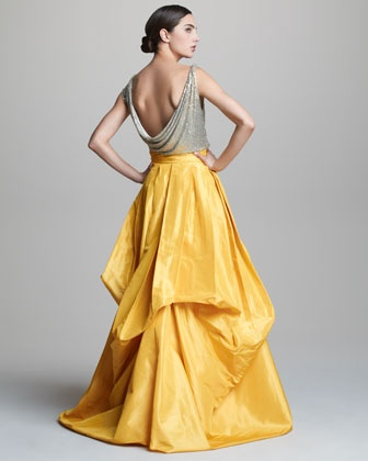 Turn heads with this dramatically structured, two-tone Naeem Khan gown.