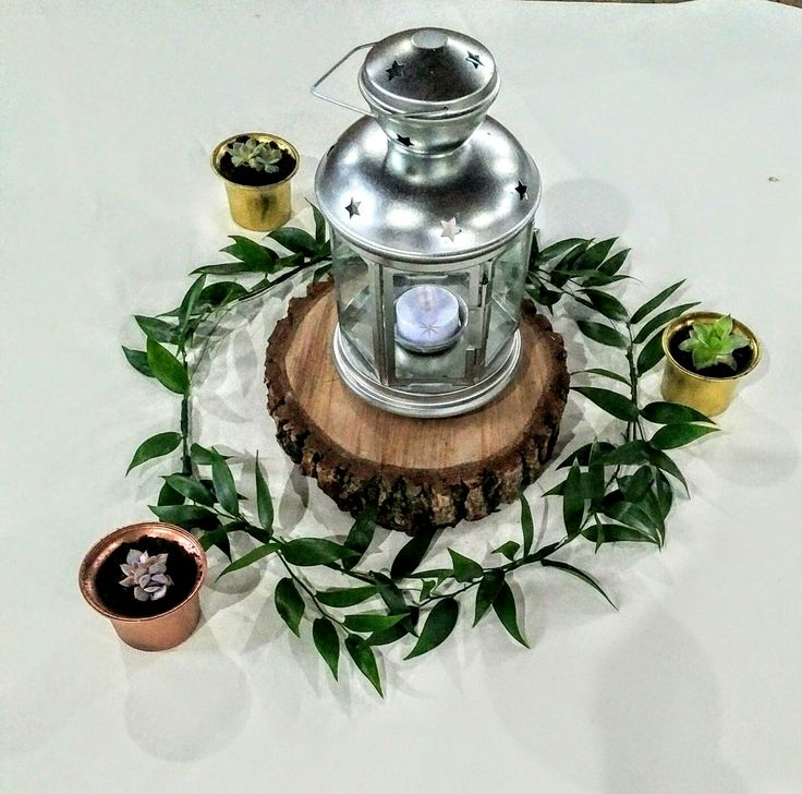 Gorgeous centerpiece for a table at a wedding or other special event.  Simple yet perfect to add to any design.  Italian ruscus, lanterns, succulents...