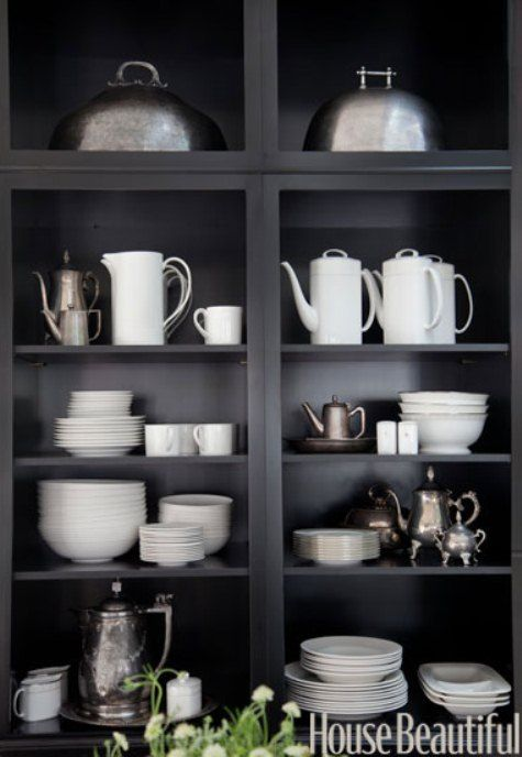 black shelving and white dishes and silverware...