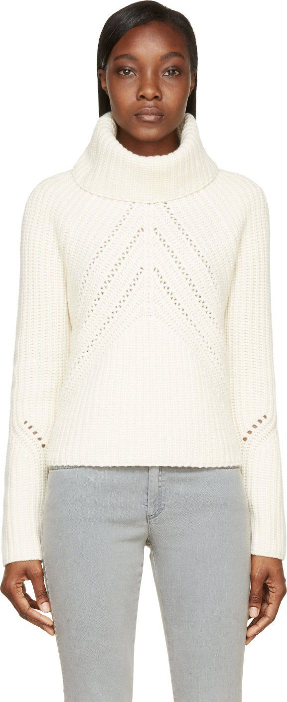Long sleeve knit pullover in ivory. Slouchy turtleneck collar. Decorative knitwork throughout. Tonal stitching.