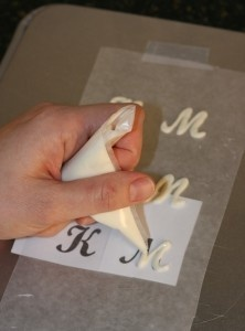 What an elegant idea! Put stencils under wax paper for chocolate letters....simply trace and then you have a gorgeous cupcake topper.