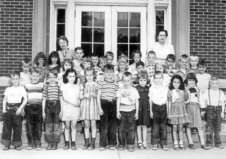 Roosevelt First Grade Class photo from the 1950-1951 school year  Front row from left: Richard Bender, Michael Karns, Bobby Carr, Janet Rah, Nancy Ogg, Chip Marshall, David Joy, Mary Sue Arrasmith, Dale Musser, Helen Politis, Judith Nichols, Conrad Androy Second row: Nichy Fox, Ann Sande, Dianna Speck, Michael Childs, Karen Smedal, Kurtis Hibbs, Kathryn Sharp, Cecil Friesenborg, Dennis Spear Third row: Patty Berg, Carol Bishop, Darrell Fowles, Bobby Strain, Craig Carver, Stephen Ades, Diane…