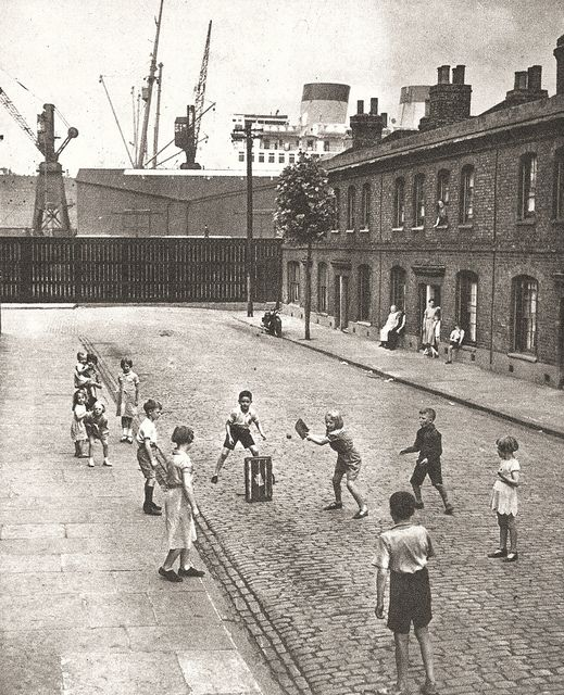 Dockland Cricket in Alpha Road, Millwall, London in the 50s. I have a reoccurring dream about a scene just like this with the huge ship looming over the small terraced houses, very odd! Taken not far from where I was born