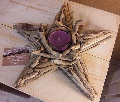Estrella-hecha-con-maderas-del-mar-y-vela