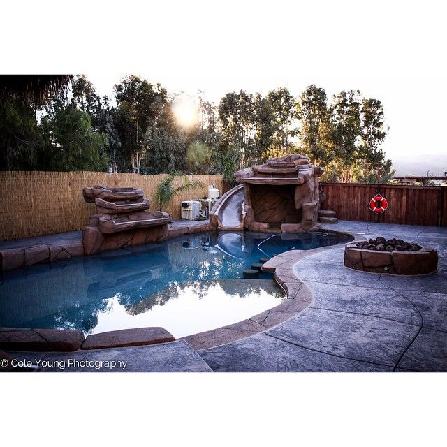 58 best rock swimming pools images on pinterest pools for Swimming pools with slides and waterfalls