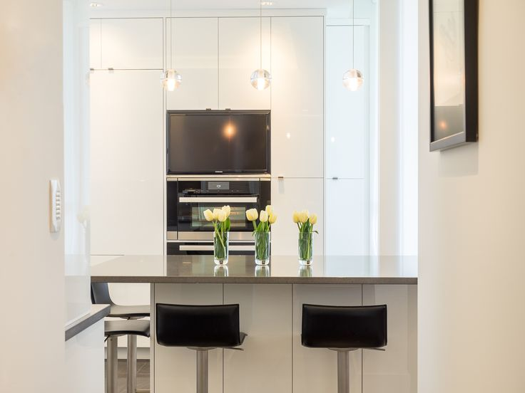 Orb Pendants and TV in a sleek and modern Victoria apartment