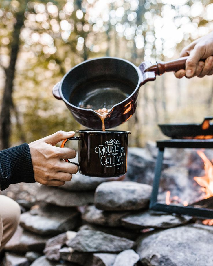 """Details Pour a mountainous amount of coffee (or soup) into our supersized enamel mug, with a design inspired by avid adventurer John Muir. - 3.5"""" W × 4"""" H - 22 oz. - Rim & handle are double dipped in"""