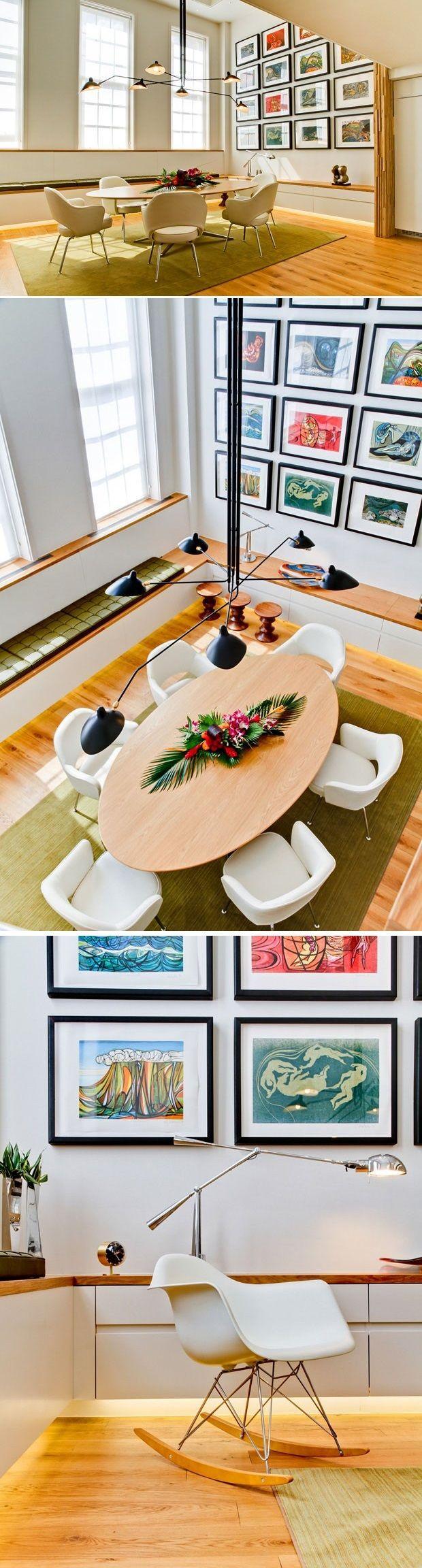 Junto à cozinha, está a vedete da residência: a ampla sala de jantar, com mesa oval de tampo de madeira e seis cadeiras robustas e confortáveis. Uma sacada interessante do ambiente é o banco contínuo que desenha as laterais da sala e pode servir tanto de aparador quanto de assento. Já o toque moderno do espaço vem da luminária pendente Mouille, da cadeira de balanço branca do casal Eames, da iluminação embutida abaixo do móvel, dos inúmeros quadros coloridos que preenchem uma das paredes.