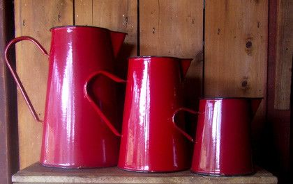 Romanian enamelware jugs in four, two and one litres.