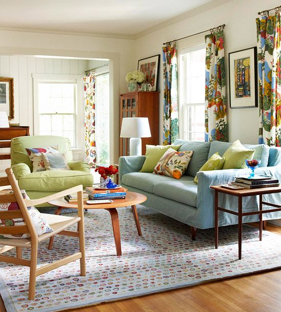Clear+Sky+Blue+++Lemony+Green+++Maplewood+Bring+your+living+room+to+life+with+exuberant+colors.+Start+your+scheme+with+one+or+two+main+colors,+then+add+in+more+hues+via+accessories+and+fabrics.+In+this+cheery+living+room,+a+blue+sofa+and+green+chair+are+the+mainstays,+along+with+a+maple+finish+on+the+wood+furniture.+From+this+foundation,+almost+anything+will+go.+This+space+gets+its+unique+character+from+patterned+curtains+and+a+rug,+both+of+which+carry+the+furniture's+colors./