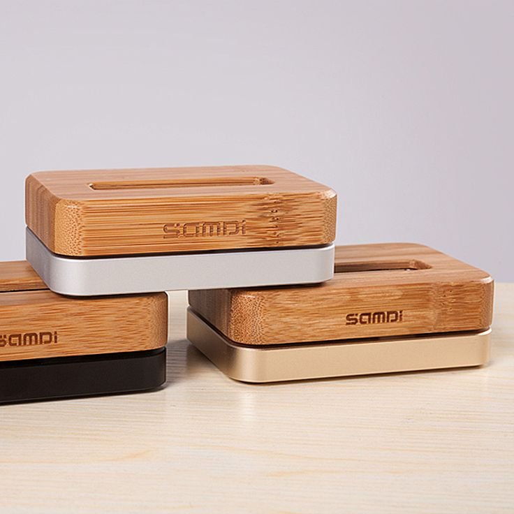 A great gadget for users of the iPhone 5, iPhone 6 / 6s & iPhone 6 Plus / 6s Plus. Wooden base for charging from natural bamboo wood and metal, in 3 shades. Handy and stylish!  Materials: Wood Bamboo, Metal Dimensions (L × W × H): 10 cm. × 7.3 cm. × 3.7 cm. Weight: 520 gr. SEE MORE-ORDER:  http://mikk.ro/cVq