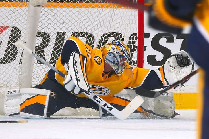 NASHVILLE, TN - JANUARY 09: Goalie Pekka Rinne #35 of the Nashville Predators stretches to make a save on a breakaway shot during the first of a game against the Edmonton Oilers period at Bridgestone Arena on January 9, 2018 in Nashville, Tennessee. (Photo by Frederick Breedon/Getty Images)