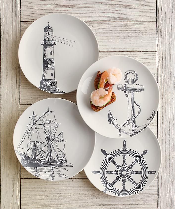 Marine Dessert Plates   Serve up a helping of deep-sea style with these dessert plates that feature a lighthouse, anchor, ship's wheel, and frigate. Set of four.