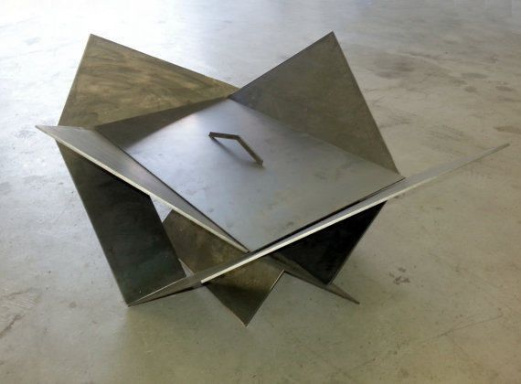 Our Modern Industrial Fire Pit is an original design thats sure to heat up your patio or backyard. Not only does it have a solid steel structure with modern lines, it is also simple to setup and breakdown for easy storage. It is a combination of origami shapes and IKEA construction in a solid, industrial metal!  The firepit is made from FOUR separate pieces of 3/16 THICK Steel guaranteed to last a lifetime in the elements. The overall dimensions are 24 tall by 30 wide and 38 long. Four s...