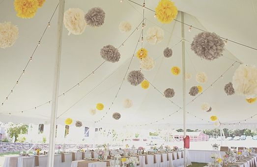 Yellow and Gray Wedding. Yellow and grey tissue pom poms! Perfect for an outdoor wedding under a big tent like this one!
