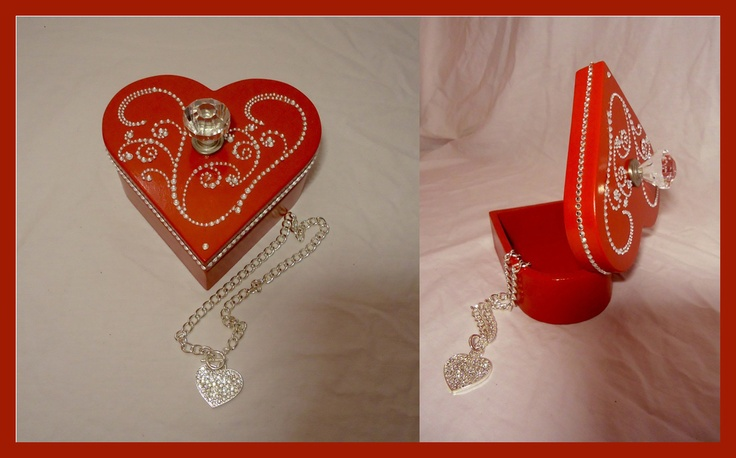 Red heart shaped-gift-box.  Diamond Knob with rhinestone accents along the side.  Makes an awesome mother's day, Valentine's or Anniversary gift.    Necklace no longer available.