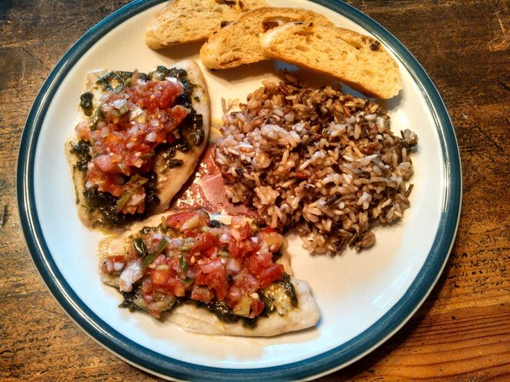 Pesto-pico tilapia, wild rice, and sun dried tomato-feta bread