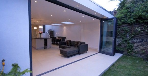 A large contemporary kitchen extension with an effortless transition to the outside garden space, SW12.   Plus Rooms