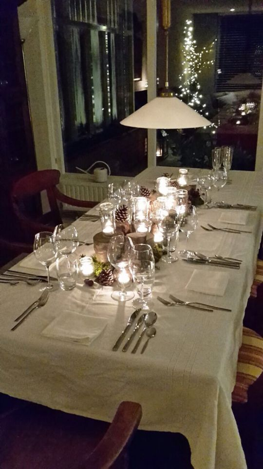 Special diner table decorations, made it with tree logs, and a lot of candles