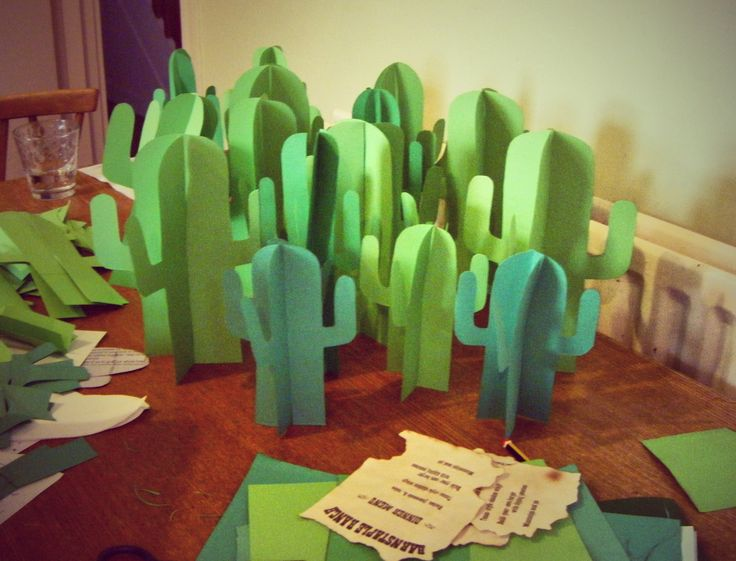 Wild West-themed cacti table decorations - Try making big ones using poster board from the dollar store...