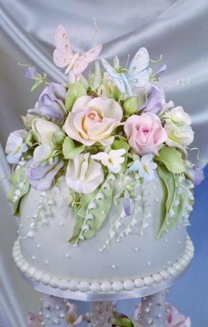 Stunning flower bouquet on top of a cake