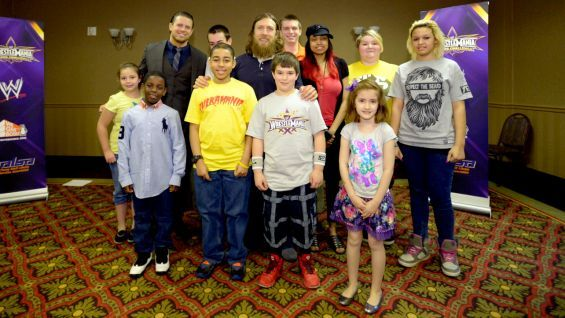 The Miz and Daniel Bryan celebrate reading with the WWE Universe during a private signing in New Orleans.