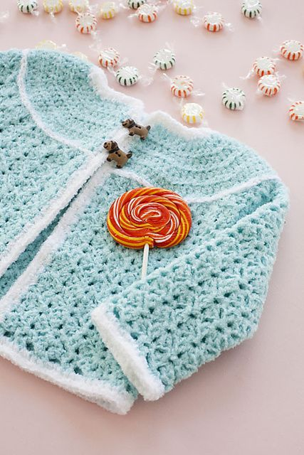 Ravelry: Candyland Sweater pattern by Robyn Chachula. Pattern published in Crochet Today! Nov/Dec 2009.