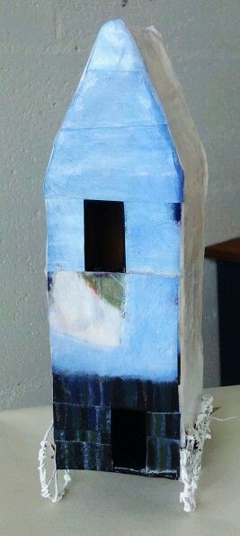 Blue house by Ivonne Mace. Paper mache and recycled wire.Price $85.