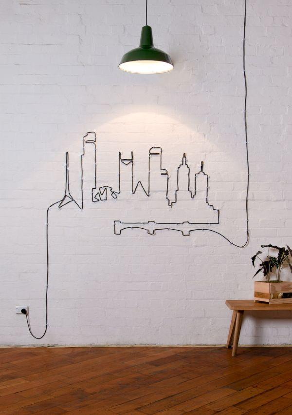 cabo da luminária cria um desenho na parede e resolve o problema dos fios aparecendo. Reciclar e Decorar : blog de decoração com ideias fáceis e baratas