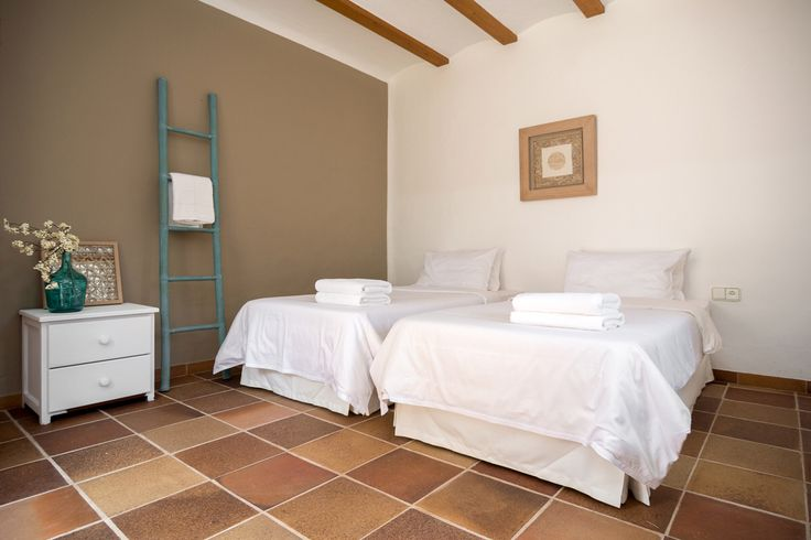 """We kept all the bedrooms in our Finca simple and tranquil.. Crisp white organic bedding is a must. After all it's a retreat centre and part of the experience is to be able to """"retreat"""" to your bedroom after a day of gorgeous food, sunshine, SUP yoga to relax, sleep well and feel rested."""