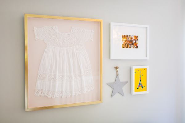 Love this heirloom outfit framed in the gallery wall. #nursery