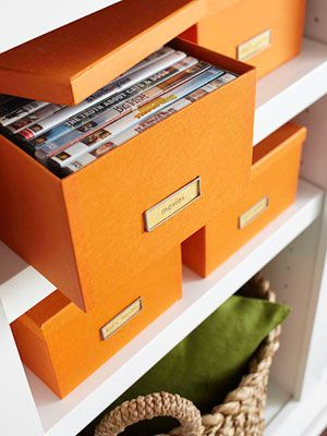 Organising DVD collection into themed boxes to declutter. An keep DVDs safe from the toddler!!