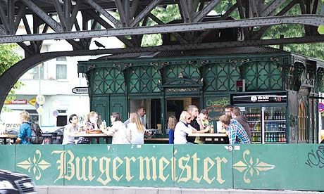 10 Best Budget Eats in Berlin : Burgermeister - With a name that requires no translation, this burger kiosk below the U-Bahn tracks is where Kreuzbergers go when in need of a meat fix. There are six types of hamburgers; vegetarians are welcomed with a tofuburger, but others should try the meistaburger, laden with mustard, onion, bacon and barbecue sauce, with a side of chilli-cheese fries. All snacks and sauces (including mango-curry) are freshly made with top-quality ingredients. Sit at…
