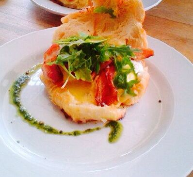 Croissant topped with poached egg, crispy pancetta and rocket served with a hollandaise sauce and a drizzle of basil pesto.