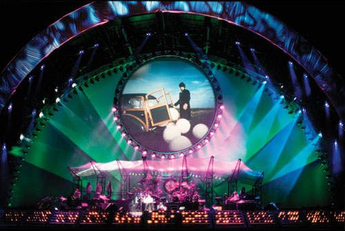 (Penton Media Inc.): The play of lights and the use of projection in the Pink Floyd concert allow the audience to see and hear the music.  I love the combination of colors, how well the pink shows up against the teal, and how even the lights are instead of appearing as multiple beams.