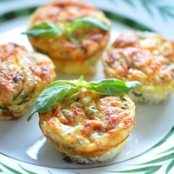 A muffin tin and fresh ingredients for individual light egg white frittatas