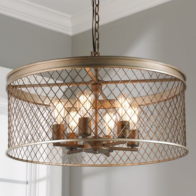 """A modern and sophisticated cage drum chandelier in a soft silver finish with bronze accents. 14.25""""Hx24.75""""W 6-100W medium base sockets.10' of chain and15' of wire included with a  5"""" canopy."""