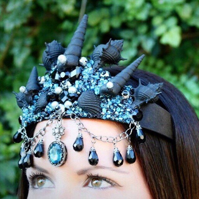 Brand new Sirens crown! Gorgeous seashell crown, with ocean blue focal gem, with ocean blue, black, and other assorted beads.