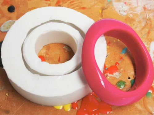 How to Make a Bangle Mold - Make a silicone mold of your favorite bangle bracelet, and then make duplicates of it in resin!