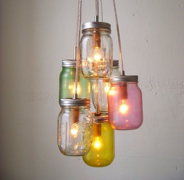 Mason Jar Chandelier! So cute, I especially love the different colored jars and how they all hang at separate lengths.