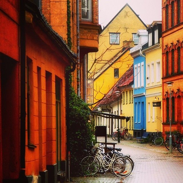 One of the most picturesque streets in #Malmö, Gamla Väster is a cozy neighborhood filled with restaurants, bars, and colorful houses.   #owegoo #malmö #travel #sweden #scandinavia #picturesque #cobblestone