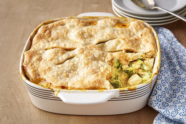 Prepare this VELVEETA® Chicken Divan Pot Pie for a delicious dinner entrée. Bake this cheesy VELVEETA® Chicken Divan Pot Pie until golden and then serve.