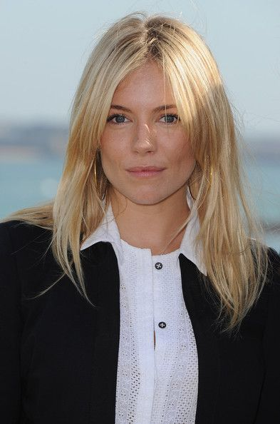Sienna Miller Layered Cut - Sienna Miller wore her hair in casual center-parted layers during the Dinard British Film Festival jury photocall.