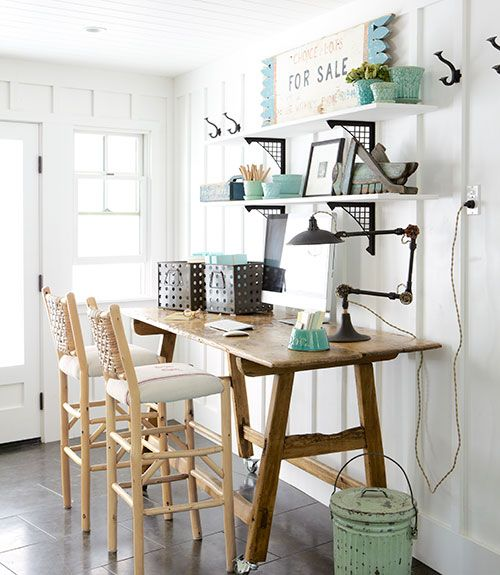 The owner of this California ranch house set up an office in the mudroom by bringing in a secondhand pine table and barstools by Old Hickory.   - CountryLiving.com