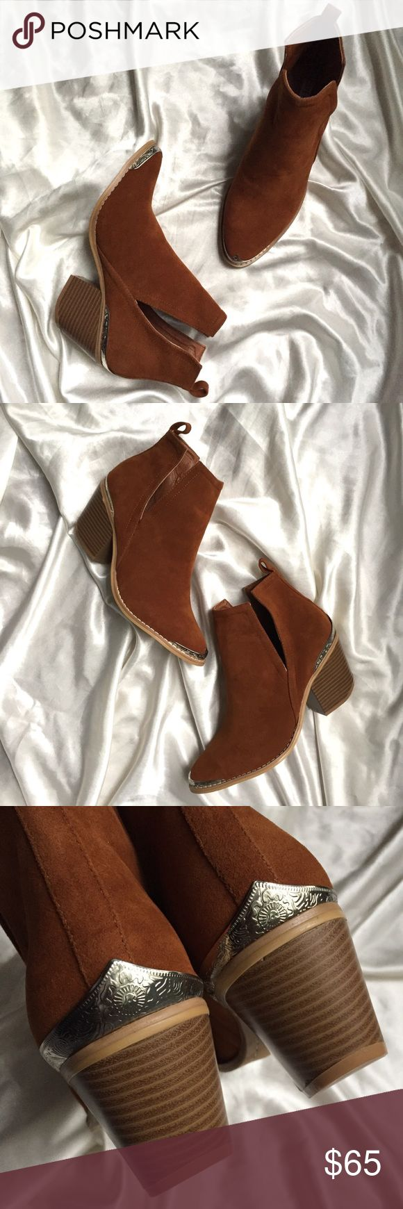 """Cognac Camel Side Cutout Western Ankle Booties These ankle booties feature silver tone etched metal hardware at the toe and heel, side v cutouts, and a pull up tab on the heel. Pair them with your skinny jeans, leggings, shorts, or dresses. Perfect for any season. Versatile color. Boho gypsy festival chic style. Heel height is approximately 3"""". New in box boutique brand booties. The Luxe Bohemian Shoes Ankle Boots & Booties"""