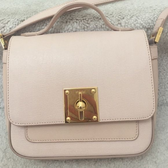 100% Authentic Fendi mini borsa bag Crossbody. Nude color Fendi mini borsa Crossbody bag. Like New, seriously. Worn twice. Great size for a party or night out. This purse is sold out everywhere. FENDI Bags Crossbody Bags