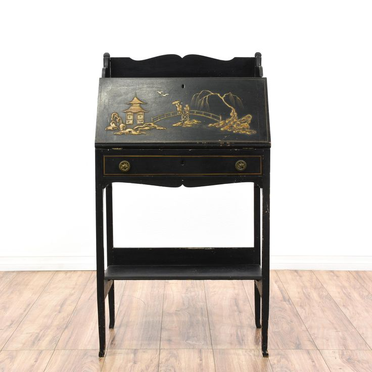 This secretary desk is featured in a solid wood with an ebonized finish. This Asian drop front desk has an etched scene, carved trim, desk with storage cubbies, and spacious single drawer. Perfect for storing paperwork! #asian #desks #secretarydesk #sandiegovintage #vintagefurniture